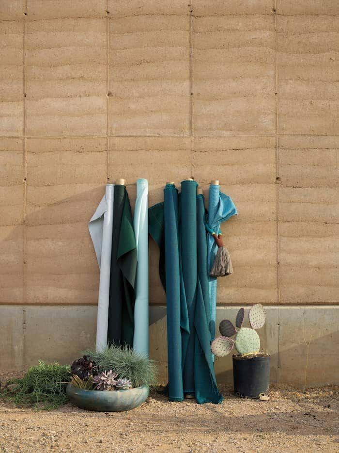 Green and blue Sunbrella performance fabric rolls
