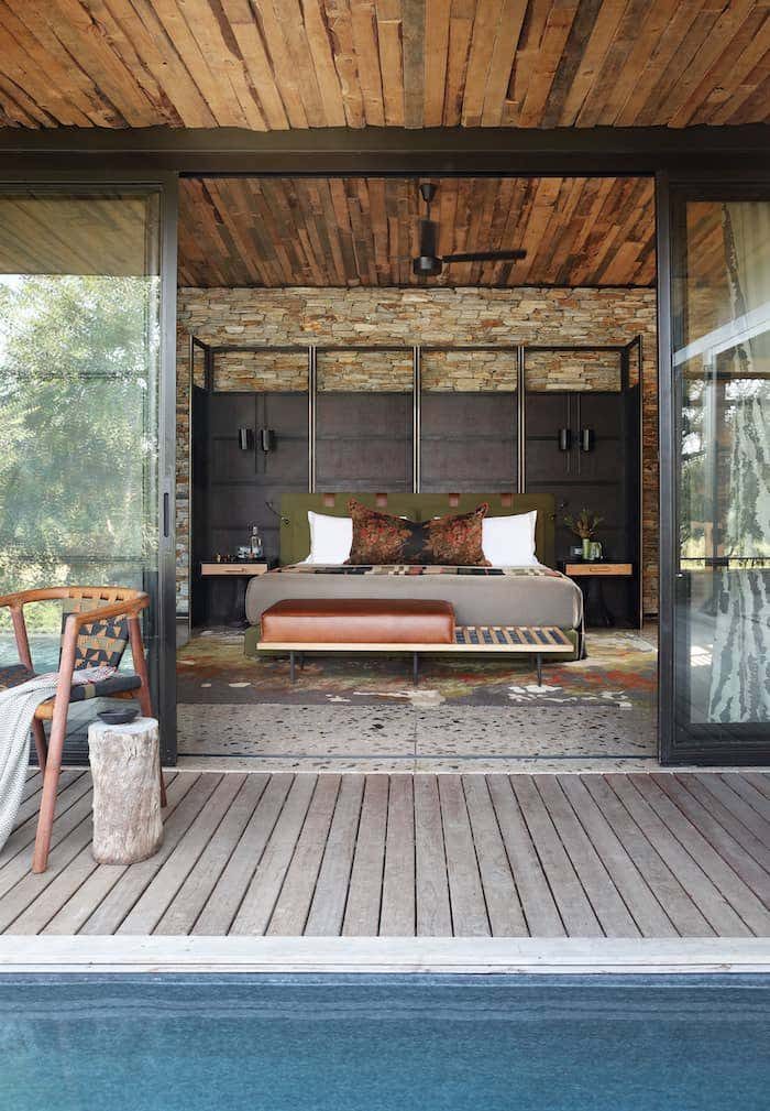 Open concept bedroom design with wood ceiling and flooring to create an indoor outdoor living space