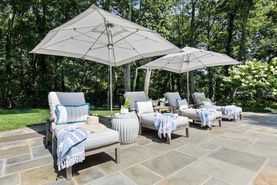 Sunbrella fabric clad cushions bring beauty and comfort to poolside lounge chairs.