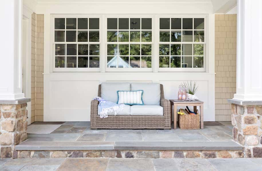 Custom upholstery on an outdoor loveseat transforms this courtyard into homeowners' exact vision.