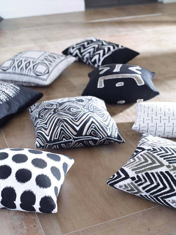 There are many ways to easily decorate a room with a black and white design with Sunbrella fabrics, like these striking decorative pillows from Mitchell Gold + Bob Williams.