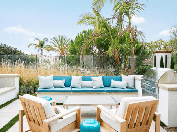 outdoor seating area with teal and white pillows