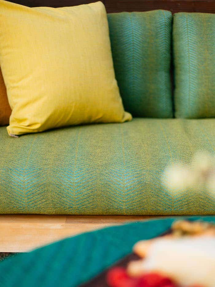 Green and yellow Sunbrella fabric upholstery is well suited to meet the demands of outdoor settings.