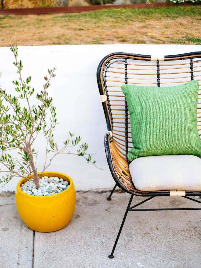 Clean and crisp Sunbrella fabrics will hold their comfort and style year after year in Dabito's backyard design.