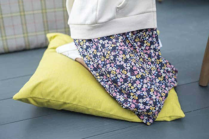 Colored Sunbrella fabric pillow offers maximum durability for your whole family to enjoy.