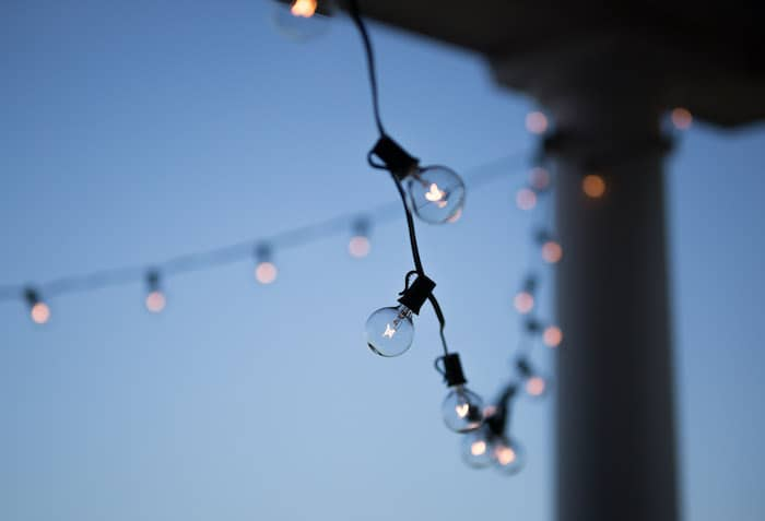 String lights bring whimsical energy to your outdoor patio design.