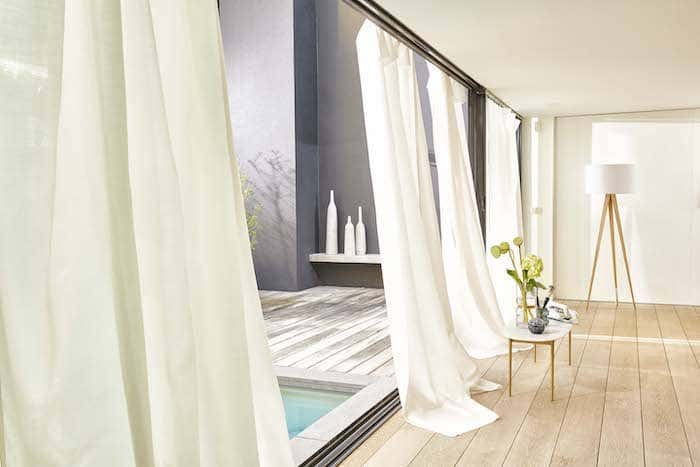 Certain curtain decor ideas likes this white floor to ceiling drapery can completely transform your space