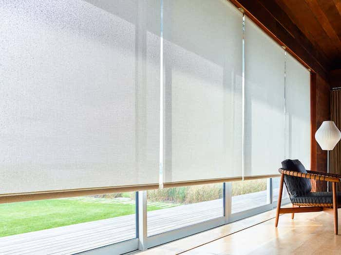 Motorized shade like this gray motorized drapery provides an essential convenience to busy households.