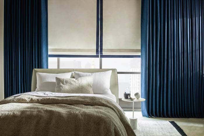 The multiple layers of curtains in this image are some of the drapery ideas that can add a new element of visual appeal to any room.