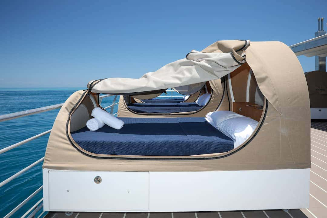 Sunbrella performance fabric covers in Heather Beige Plus protect above deck sleeping pods so guests can enjoy them again and again.