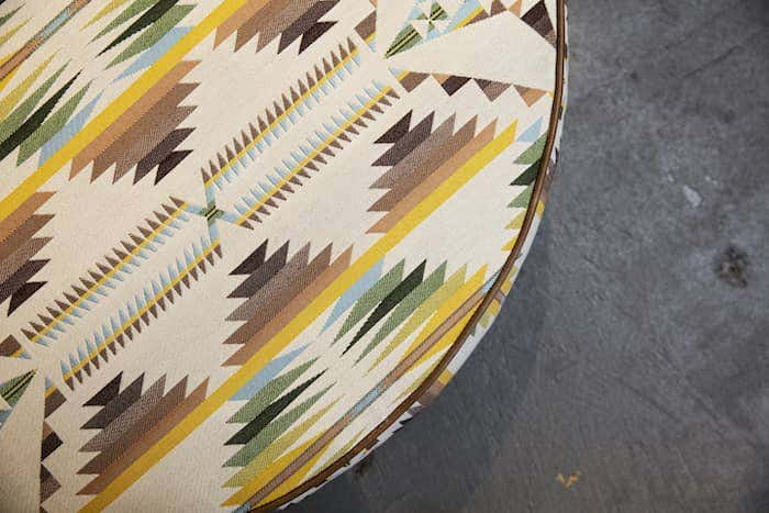 Ottoman upholstered in Americana geometric print with Sunbrella performance fabrics featured at High Point Market.