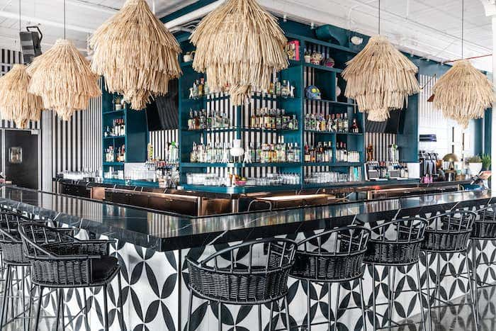 House of Nomad used the combination of black and white and pops of color to curate a care-free restaurant design style.