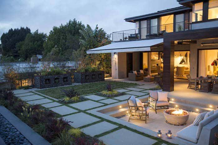 Backyard design with neutral Sunbrella fabrics and retractable shade awning