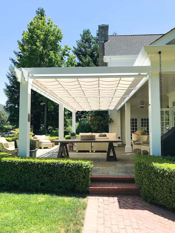 Neutral Sunbrella fabric on a classic ShadeTree pergola adds polish to outdoor spaces.