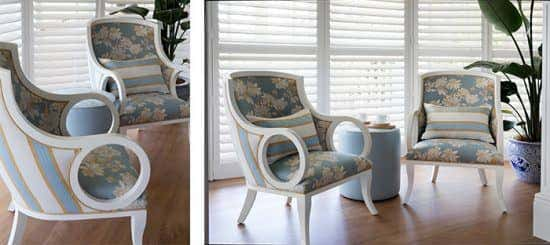 A pair of vintage arm chairs reupholstered with pale blue, patterned Sunbrella fabrics.