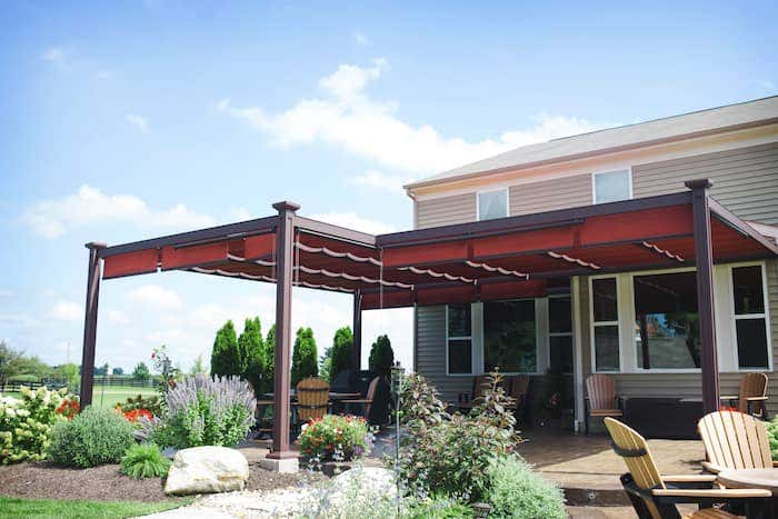 A shade structure from ShadeTree with Sunbrella fabrics extends the comfort and coolness of an indoor space for your yard or patio while creating dimension and polished style.
