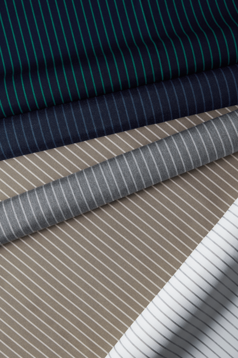 Luxurious striped fabrics from Sunbrella's Dimension Collection, featured in Indigo, Prep, Smoke, and Taupe.