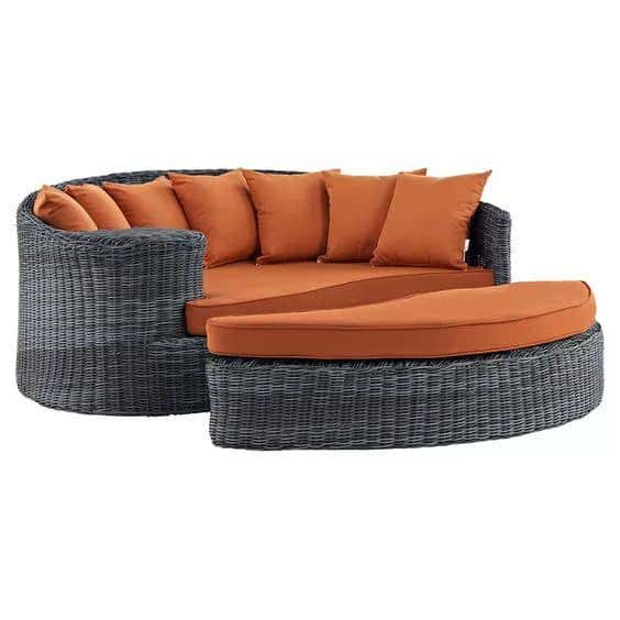 A circular daybed lounger brings premium comfort for backyard leisure.