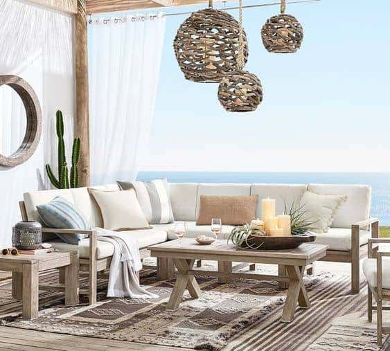A white Sunbrella upholstered outdoor sectional brings premium performance power to your patio setup.