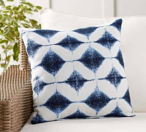 A bold blue and white pattern creates depth and interest in outdoor design.
