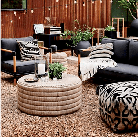 Backyard patio design with a teak wood outdoor furniture set with charcoal Sunbrella outdoor upholstery fabric