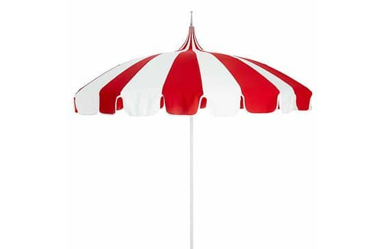 Choose a patio umbrella with personality, like this red and white striped shade.