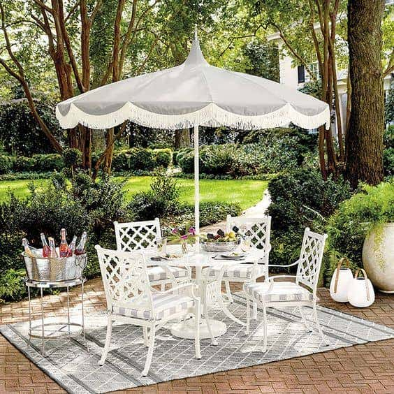 Outdoor patio umbrellas, like this elegant one, provide shade and style for outdoor enjoyment.