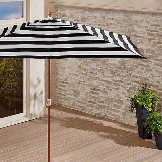 Large patio umbrellas from Crate & Barrel can turn any outdoor patio into a comfortable haven.
