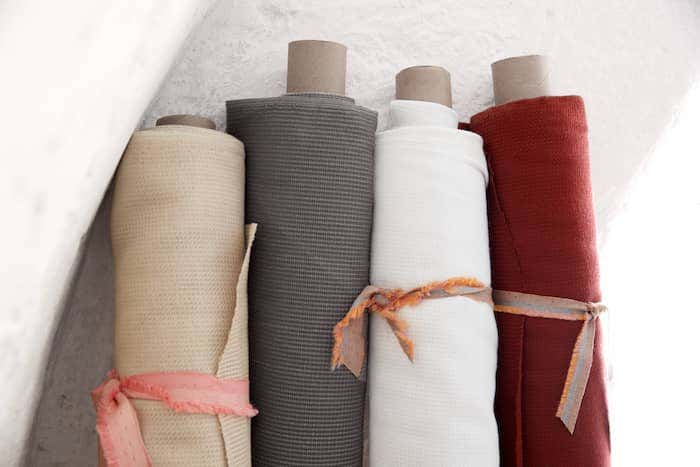 Neutral, gray, white, and red Sunbrella performance fabrics