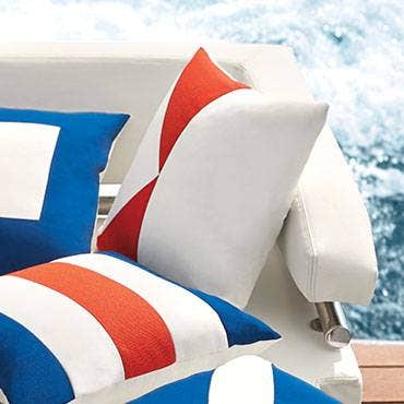 Blue and orange Sunbrella marine pillows
