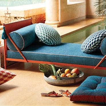 Blue pillows on bench with cushion