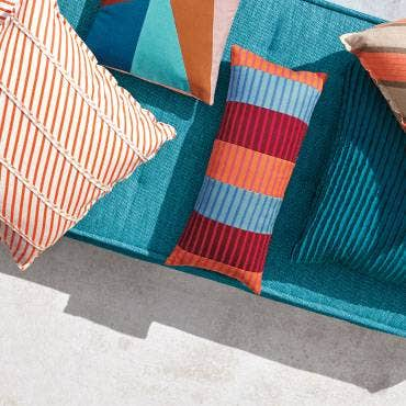 Orange and blue patterned pillows