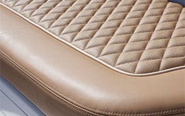 close up for quilted tan cushion