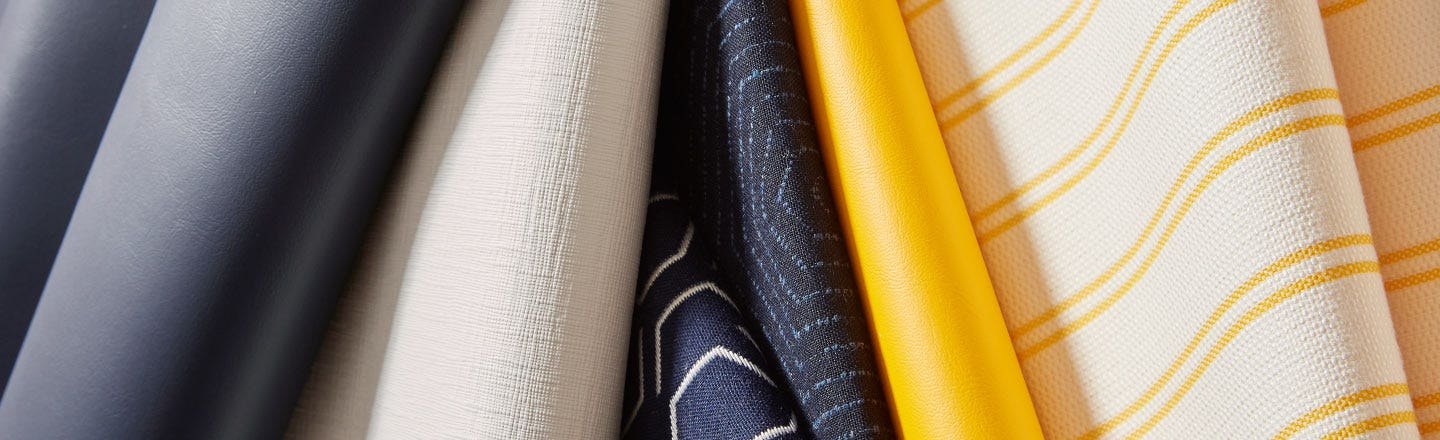 Blue yellow and white striped marine upholstery fabric