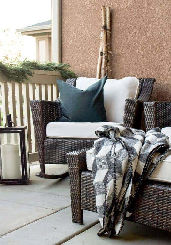 Create a cozy outdoor seating space with durable Sunbrella-covered cushions.