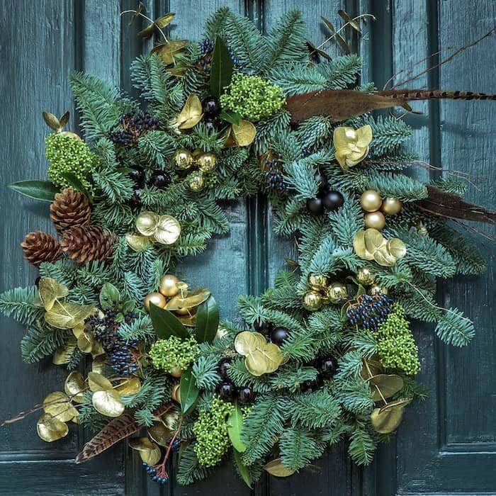 A cheery wreath is a fun, easy piece of decor to dial up your front porch decorating for Christmas.