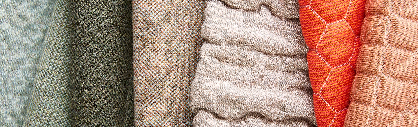 Gray tan and white upholstery fabrics ropes and thread