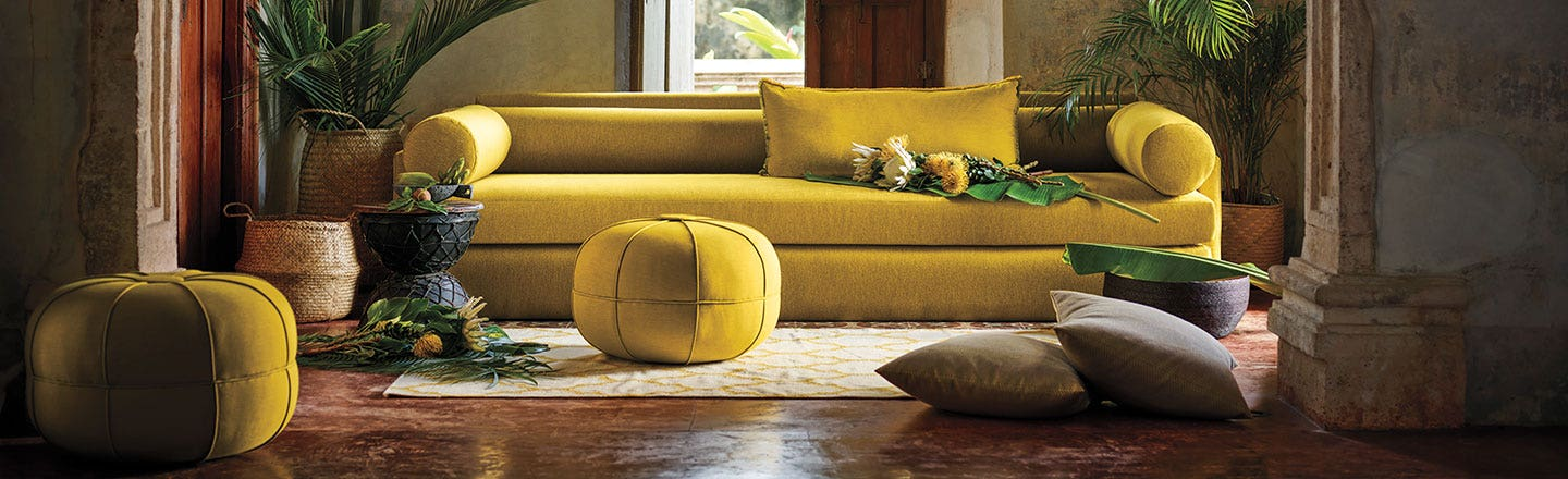 modern mustard couch with ottomans and pillows