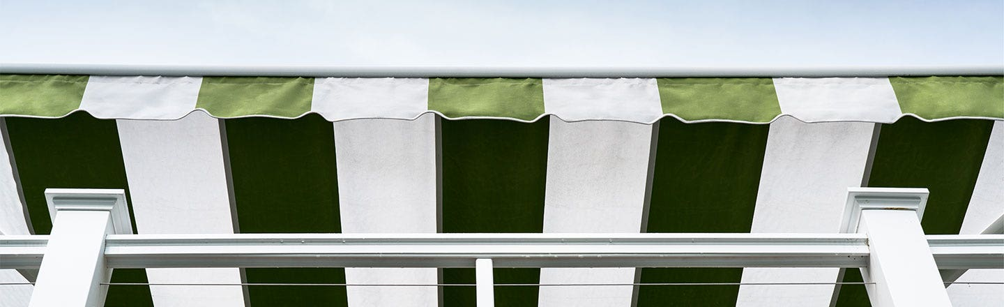 Closeup of green and white awning