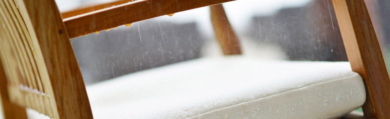 Rain on a white outdoor cushion with Sunbrella fabric