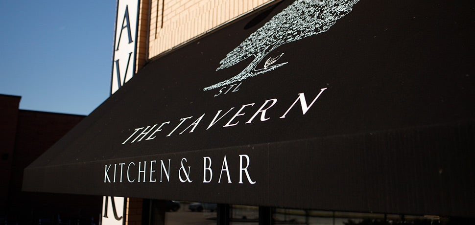 Dark restaurant awning with logo and text printed