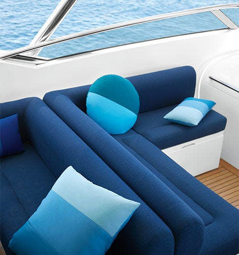 Blue boat sofa with blue pillows