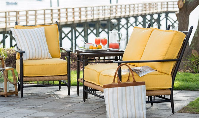Bright yellow cushions on patio chairs