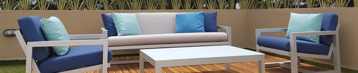 Blue cushions and pillows on outdoor furniture