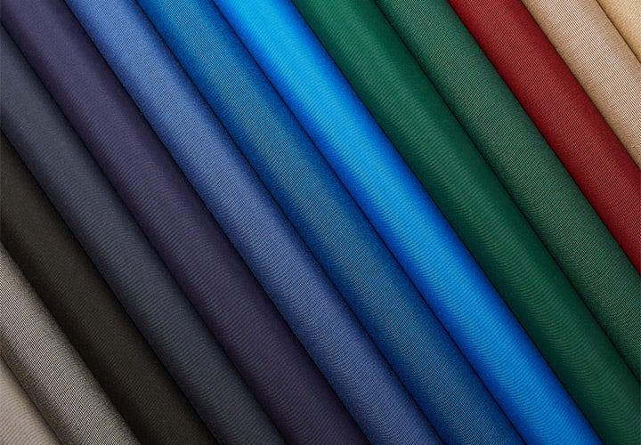 Close up of a colorful assortment of Sunbrella SeaMark fabrics