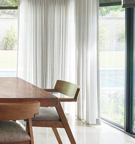 White sheer curtain in dining room