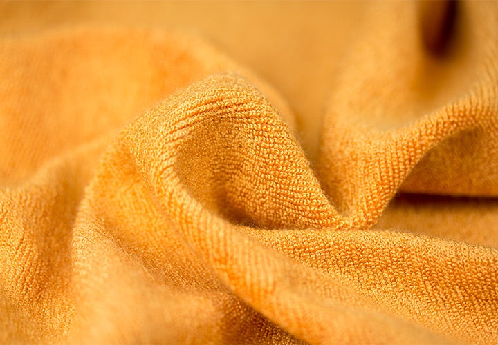 Closeup of orange Terry fabric