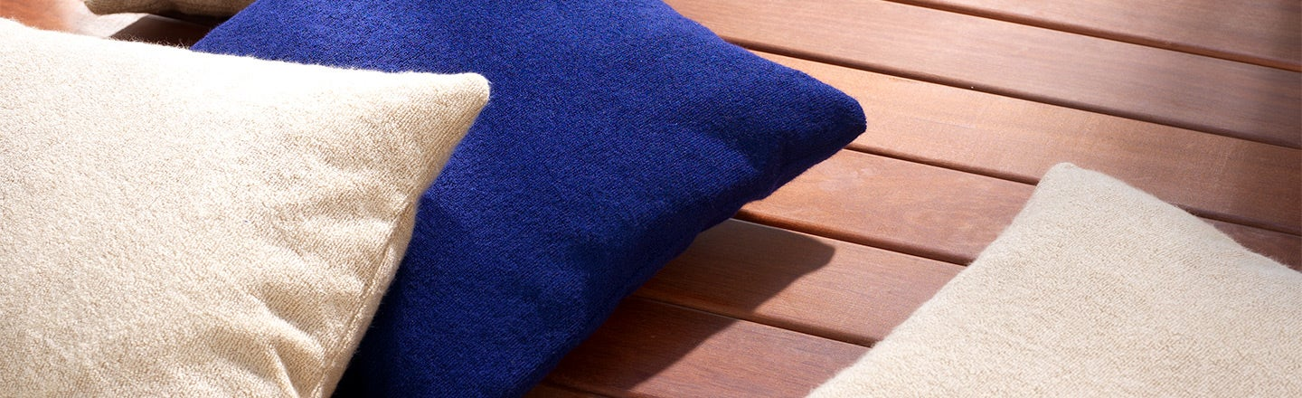 White and blue Terry pillows on patio
