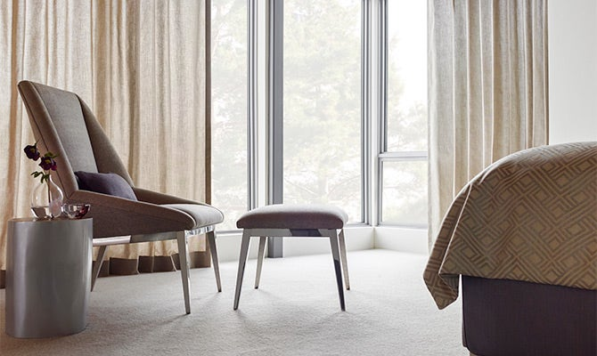Soft beige curtains in a bedroom window