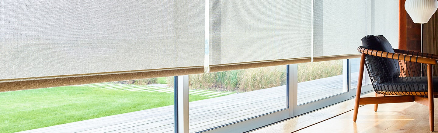 Beige Sunbrella shades slightly covering window
